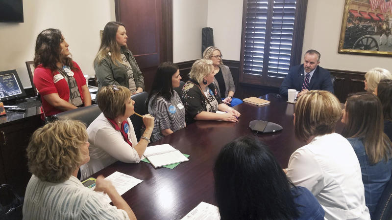 In this April 16, 2019, photo, parents from Putnam City, Edmond and Deer Creek public school districts meet with Senate President Pro Tempore Greg Treat, R-Oklahoma City at his Capitol office in Oklahoma City, Oka. Although there was no organized walkout in Oklahoma this year, teachers and parents visited regularly with their lawmakers to lobby for education, and new Parent Legislative Action Committee chapters are popping up at districts across the state. (Courtesy of Erin Brewer via AP).