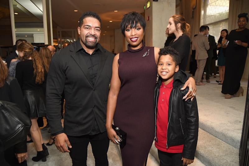 Hudson and Otunga, pictured with their son in December 2016, have been together about 10 years. (Michael Kovac via Getty Images)