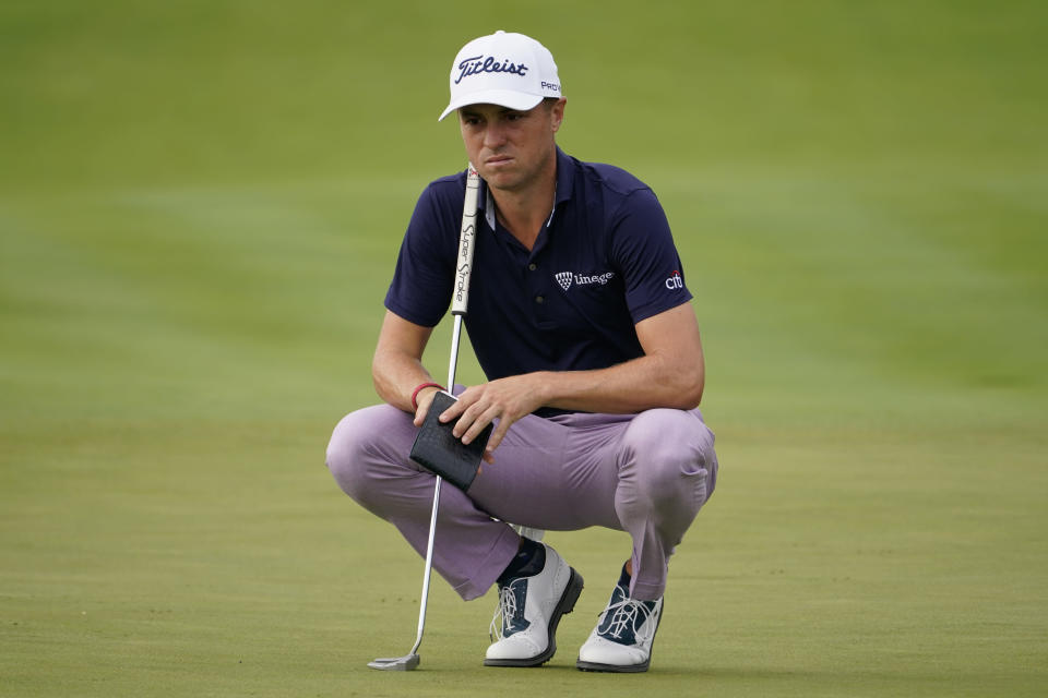 Justin Thomas reads the 12th green before putting in the second round at the Northern Trust golf tournament, Friday, Aug. 20, 2021, at Liberty National Golf Course in Jersey City, N.J. (AP Photo/John Minchillo)