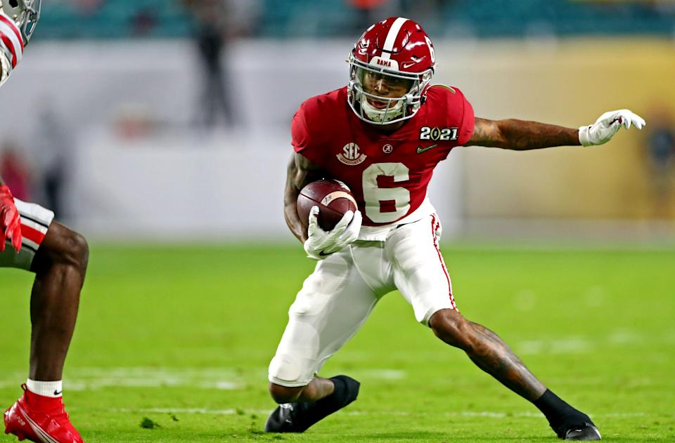 Alabama wide receiver DeVonta Smith runs with the ball during the first quarter Jan. 11, 2021.