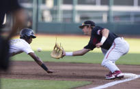 Stanford's Nick Brueser (24), right, tags out Vanderbilt's Enrique Bradfield Jr (51) on a dive back to first base in the first inning during a baseball game in the College World Series Wednesday, June 23, 2021, at TD Ameritrade Park in Omaha, Neb. (AP Photo/Rebecca S. Gratz)