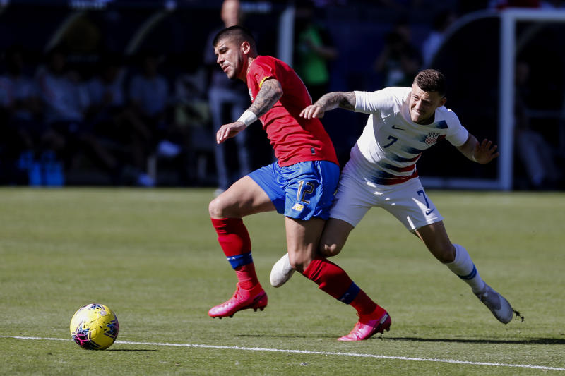Costa Rica midfielder Ulises Segura (12) and United States forward Paul Arriola (7) vie for the ball during the first half of an international friendly soccer match in Carson, Calif., Saturday, Feb. 1, 2020. (AP Photo/Ringo H.W. Chiu)