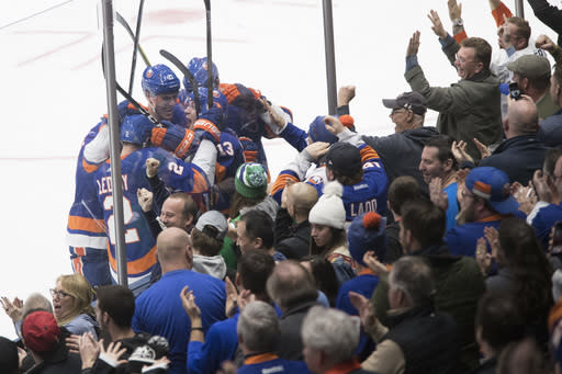 New York Islanders center Mathew Barzal (13) celebrates after scoring a goal during the third period of an NHL hockey game against the Detroit Red Wings, Saturday, Dec. 15, 2018, in Uniondale, N.Y. (AP Photo/Mary Altaffer)