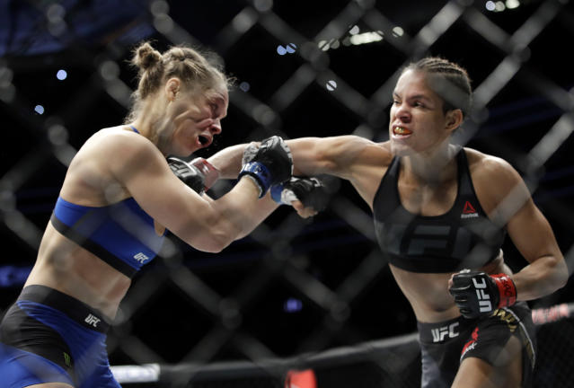 Amanda Nunes connects with Ronda Rousey at UFC 207, Friday, Dec. 30, 2016, in Las Vegas. Nunes won the fight after it was stopped in the first round. (AP)