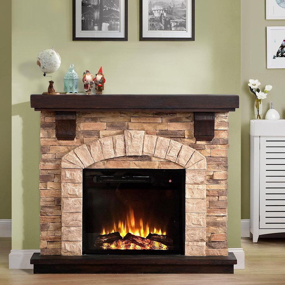 <p>This <span>Manford Electric Fireplace</span> ($520, originally $800) looks so cozy and traditional.</p>