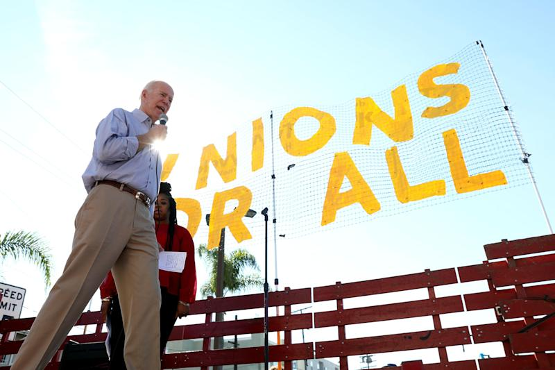 Former Vice President Joe Biden speaks to McDonald's cooks and cashiers on a picket line in December. (Photo: Patrick Fallon / Reuters)