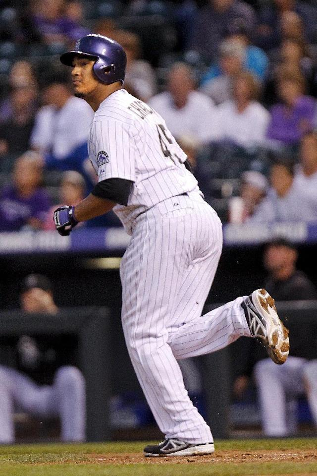 Colorado Rockies starting pitcher Jhoulys Chacin watch his home run ball leave the park on a pitch from Arizona Diamondbacks' Randall Delgado during the third inning of a baseball game on Friday, Sept. 20, 2013, in Denver. (AP Photo/Barry Gutierrez)