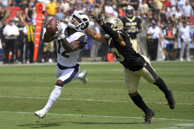 Los Angeles Rams wide receiver Brandin Cooks, left, catches a pass inform of New Orleans Saints cornerback Marshon Lattimore during the first half of an NFL football game Sunday, Sept. 15, 2019, in Los Angeles. (AP Photo/Mark J. Terrill)