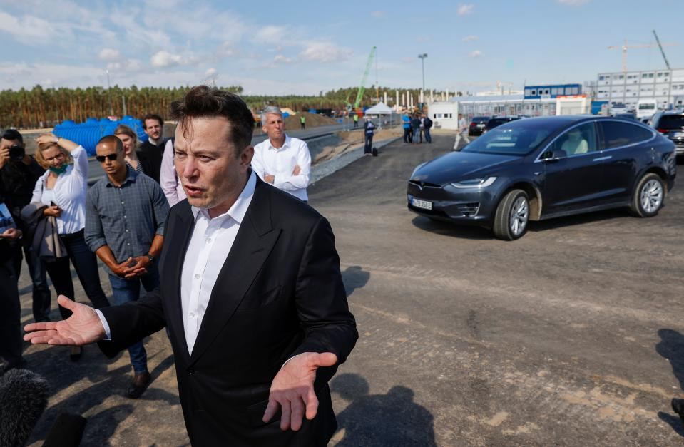 Tesla CEO Elon Musk talks to media as he arrives to visit the construction site for Tesla factory in Grünheide near Berlin, Germany in September 2020. Photo: Odd Andersen/AFP via Getty Images