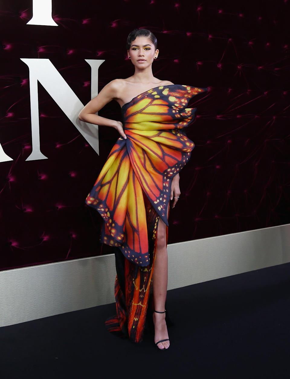 """<p><a href=""""https://www.popsugar.com/fashion/Zendaya-Butterfly-Dress-Greatest-Showman-Premiere-44444355"""" class=""""link rapid-noclick-resp"""" rel=""""nofollow noopener"""" target=""""_blank"""" data-ylk=""""slk:Zendaya's Moschino butterfly dress"""">Zendaya's Moschino butterfly dress</a> at the Australia premiere of <strong>The Greatest Showman</strong> called for little more than a pair of Stuart Weitzman sandals. She arrived to the carpet under an umbrella, sheltered from the rain and ready to spread her wings.<br> </p><hr>"""