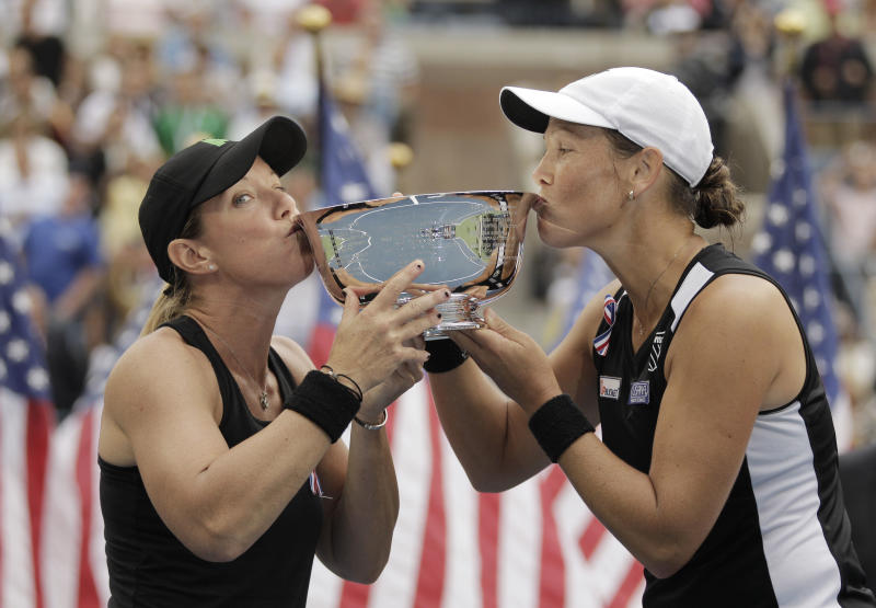 Lisa Raymond, left, and Liezel Huber kiss the championship trophy after winning their women's doubles final match against Vania King and YaroslavaShvedova of Kazakhstan  during a women's doubles final at the U.S. Open tennis tournament in New York, Sunday, Sept. 11, 2011. (AP Photo/Elise Amendola)