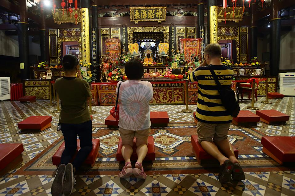 SINGAPORE - JANUARY 24:  Worshippers pray at the Thian Hock Keng temple on January 24, 2020 in Singapore. On January 25, people around the world will welcome the Year of the Rat, one of the most anticipated holidays on the Chinese calendar. Also known as the Spring festival or the Lunar New Year, the celebrations last for about 15 days.  (Photo by Suhaimi Abdullah/Getty Images)