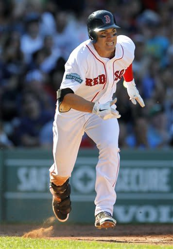 Boston Red Sox's Jacoby Ellsbury runs toward first base as he pops out on a pitch by Kansas City Royals' Francisley Bueno in the seventh inning of a baseball game at Fenway Park in Boston, Sunday, Aug. 26, 2012. The Red Sox won 8-6. (AP Photo/Steven Senne)