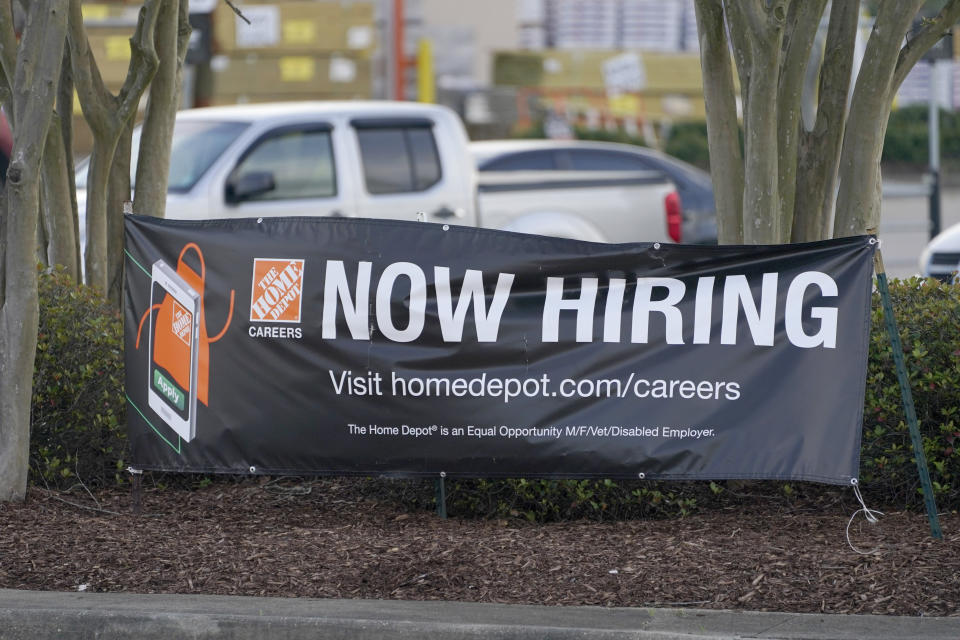A roadside banner beckons potential employees outside a Home Depot store in Hattiesburg, Miss., March 27, 2021. The number of Americans applying for unemployment benefits rose by 61,000 last week to 719,000, signaling that many employers are still cutting jobs even as more businesses reopen, vaccines are increasingly administered and federal aid spreads through the economy.   (AP Photo/Rogelio V. Solis)