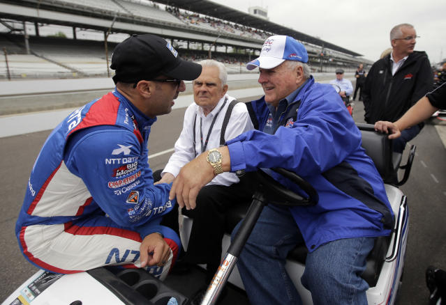 FILE - In this May 16, 2015, file photo, Tony Kanaan, left, of Brazil, talks with car owner and four-time Indianapolis 500 champion AJ Foyt on the first day of qualifications for the Indianapolis 500 auto race at Indianapolis Motor Speedway in Indianapolis. Organizers announced Thursday, March 26, the 500 would move from its traditional Memorial Day weekend slot to Aug. 23. Drivers, like fan favorite Kanaan, jumped right on board calling it the right move. Foyt issued a statement saying IndyCar officials were doing the best they could under unforeseen circumstances. (AP Photo/Darron Cummings, File)
