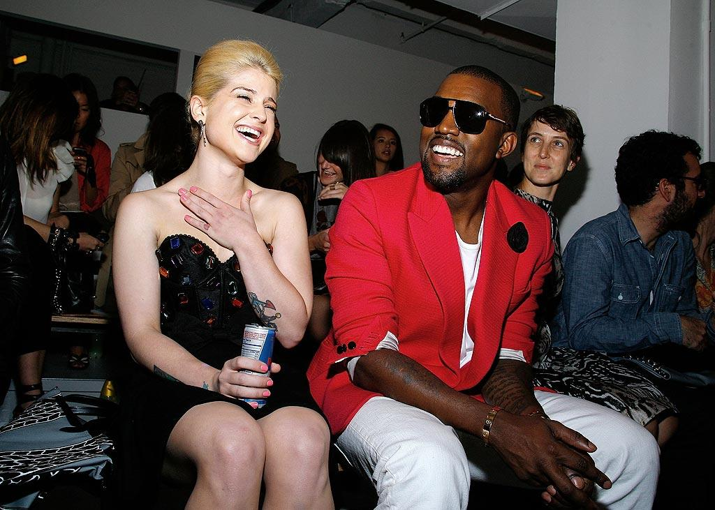 """After appearing at the VMAs in L.A., Kanye West flew back to NYC, where he performed with Jay-Z and took in some runway shows during New York Fashion Week. The rapper was snapped cracking up Kelly Osbourne at the Jeremy Scott Spring 2011 show. Who knew Kanye was so funny? Andy Kropa/<a href=""""http://www.gettyimages.com/"""" target=""""new"""">GettyImages.com</a> - September 15, 2010"""