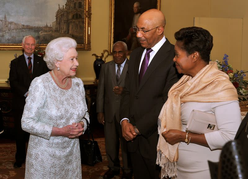 FILE PHOTO: Queen Elizabeth talks with Jamaica's Governor General Patrick Allen and his wife Patricia during a reception for Commonwealth Governors General at Buckingham Palace in central London
