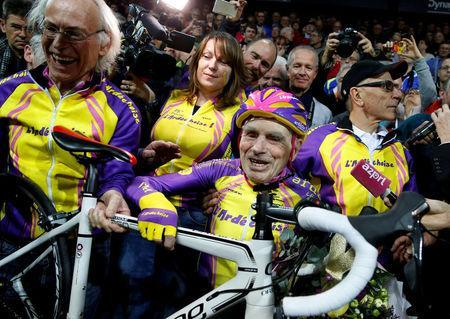 FILE PHOTO: French cyclist Robert Marchand, aged 105, reacts after he rode 22.528 km (14.08 miles) in one hour to set a new record at the indoor Velodrome National in Montigny-les-Bretonneux, southwest of Paris, France, January 4, 2017. REUTERS/Jacky Naegelen/File Photo