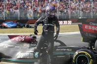 Mercedes driver Lewis Hamilton of Britain leaves his car after crashing with Red Bull driver Max Verstappen of the Netherlands during the Italian Formula One Grand Prix, at Monza racetrack, in Monza, Italy, Sunday, Sept.12, 2021. (AP Photo/Luca Bruno)