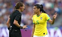 Referee Marie-Soleil Beaudoin talks to Thaisa of Brazil during the 2019 FIFA Women's World Cup France Round Of 16 match between France and Brazil at Stade Oceane on June 23, 2019 in Le Havre, France. (Photo by Alex Grimm/Getty Images)