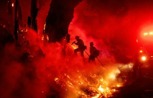 Firefighters try to control one of the fires in California this month.Such blazes are intensifying due to climate change