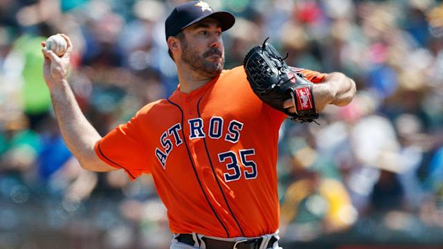 Justin Verlander earned his 200th career win, helping the Astros maintain first place over the Athletics on Sunday.