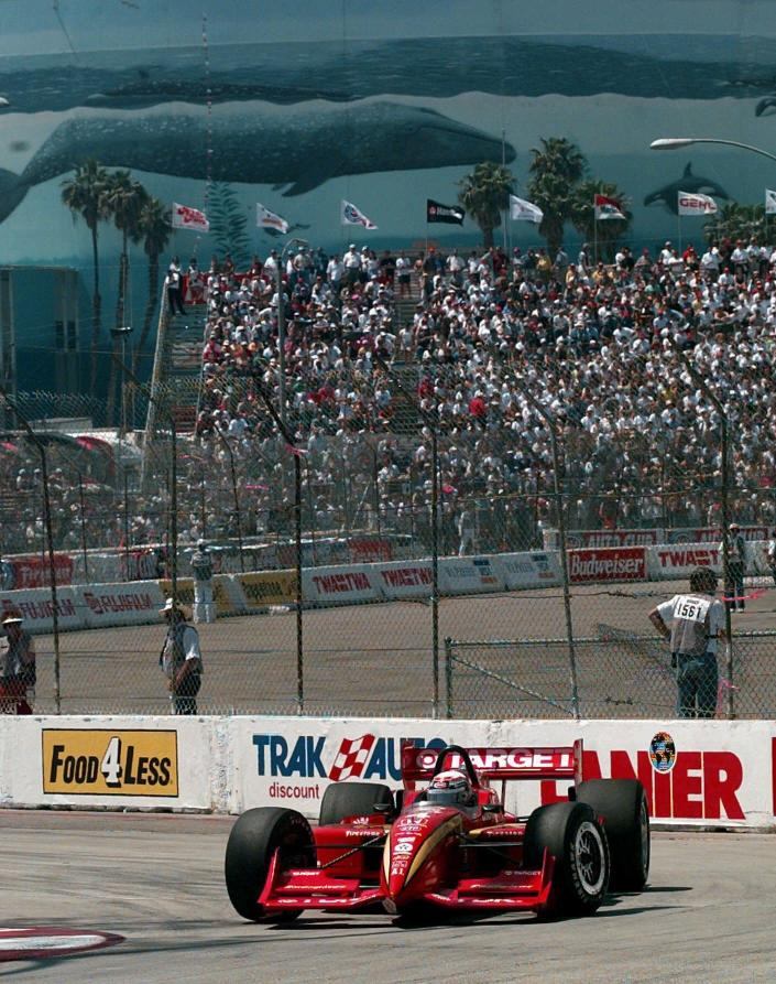 FILE - Italian driver Alex Zanardi rounds the eighth turn of the Toyota Grand Prix of Long Beach in Long Beach, Calif., in this Sunday, April 13, 1997, file photo. A Wyland whale mural is on the wall of a building behind the grandstands. (AP Photo/Kevork Djansezian)