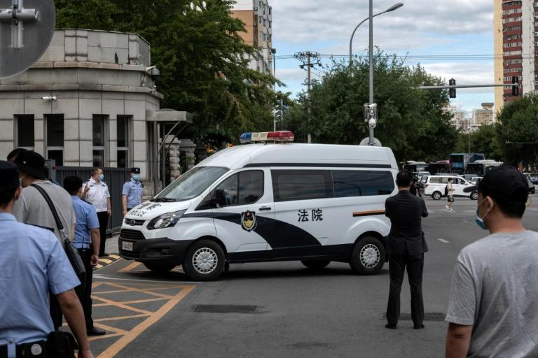 A police van carrying Ren Zhiqiang, a Chinese tycoon and outspoken critic of President Xi Jinping, arrives at court at the beginning of his trial earlier this month