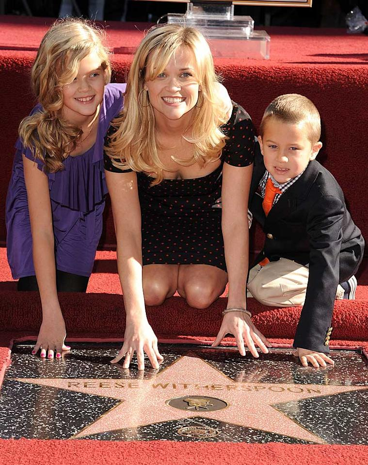 """Sporting a cute Dolce & Gabbana dress, Reese Witherspoon was honored with a star on the Hollywood Walk Of Fame on Wednesday. The """"How Do You Know"""" actress, who brought along her two kids, Ava, 11, and Deacon, 7, for the festivities, scored the 2,425th star, which is located in front of the W Hotel in Hollywood. Steve Granitz/<a href=""""http://www.wireimage.com"""" target=""""new"""">WireImage.com</a> - December 1, 2010"""