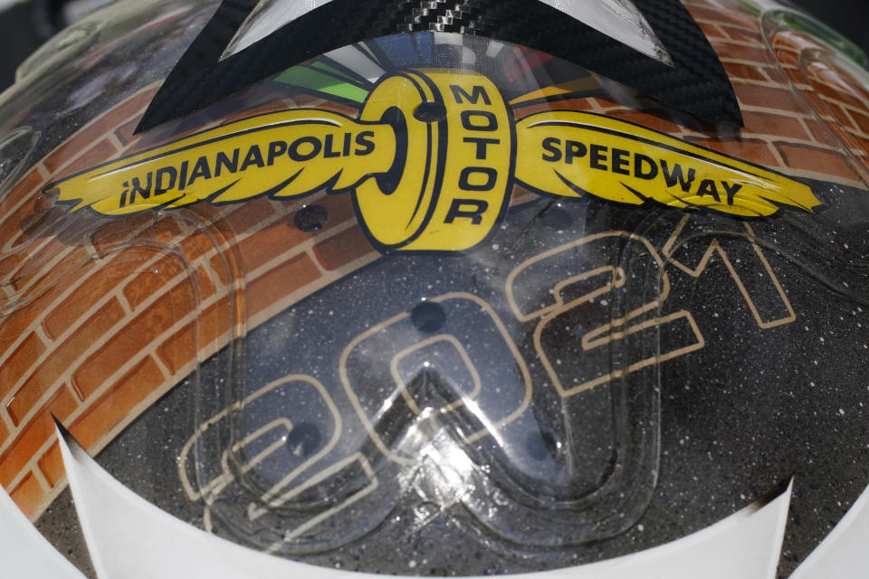 The helmet of Simona De Silvestro, of Switzerland, shows a logo during practice for the Indianapolis 500 auto race at Indianapolis Motor Speedway, Thursday, May 20, 2021, in Indianapolis. (AP Photo/Darron Cummings)