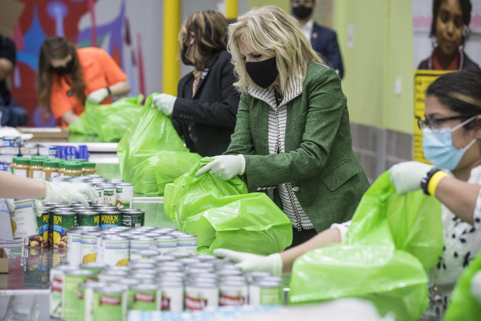 First Lady Jill Biden helps pack a backpack buddy bag of food with volunteers at the Houston Food Bank, Friday, Feb. 26, 2021, in Houston. (Brett Coomer/Houston Chronicle via AP)