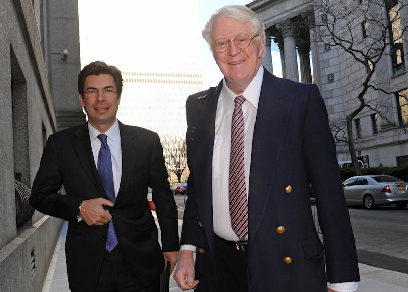 Florida energy magnate William Koch, right, arrives at Manhattan federal court, Wednesday, March 27, 2013, in New York. Koch alleges in a federal lawsuit that California businessman Eric Greenberg sold him $300,000 in vintage wine, some of it supposedly dated to 1805, that turned out to be phony.  (AP Photo/Louis Lanzano)