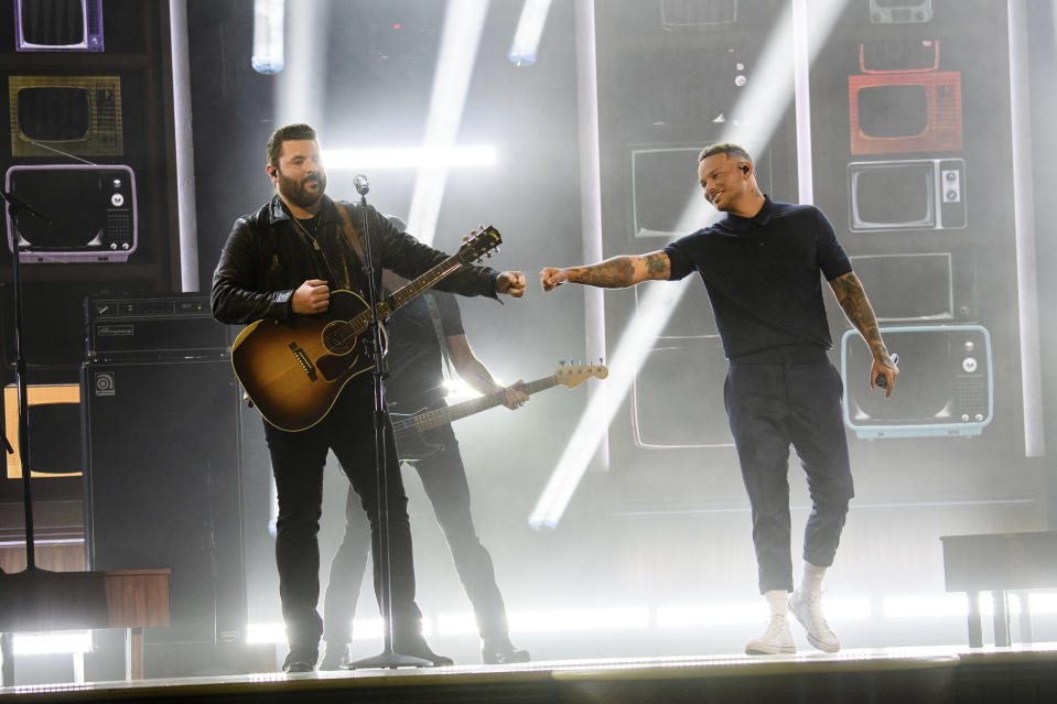 Chris Young, left, and Kane Brown perform at the 56th annual Academy of Country Music Awards on Friday April 16, 2021 at the Ryman Auditorium in Nashville, Tenn. The awards show airs on April 18 with both live and prerecorded segments. (Photo by Amy Harris/Invision/AP)