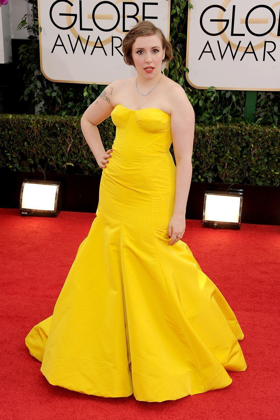 <p>Lena Dunham went for a Disney princess vibe at the 2014 Golden Globes in this bright yellow dress designed by Zac Posen.</p>