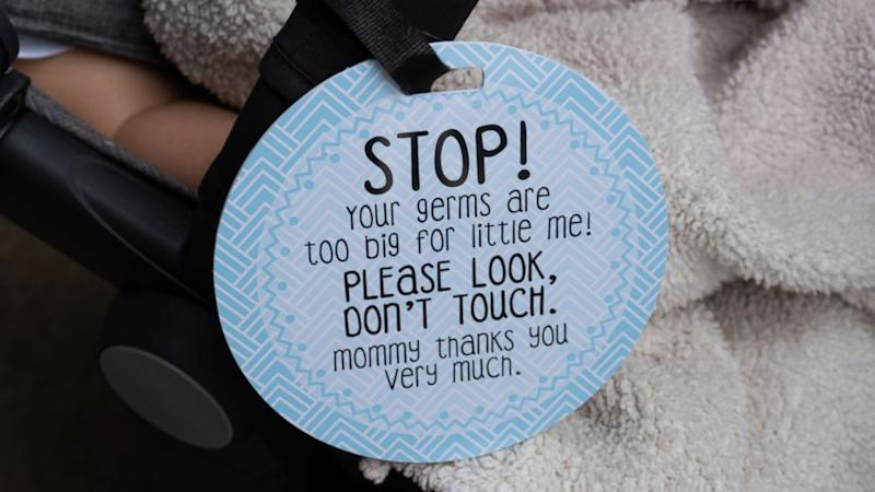 Momtroversy: Are 'don't touch' signs for baby a great idea or overkill?