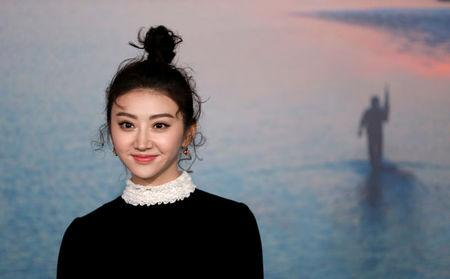 """Cast member Tian Jing poses at the premiere of """"Kong: Skull Island"""" in Los Angeles, California, U.S. March 8, 2017. REUTERS/Mario Anzuoni"""
