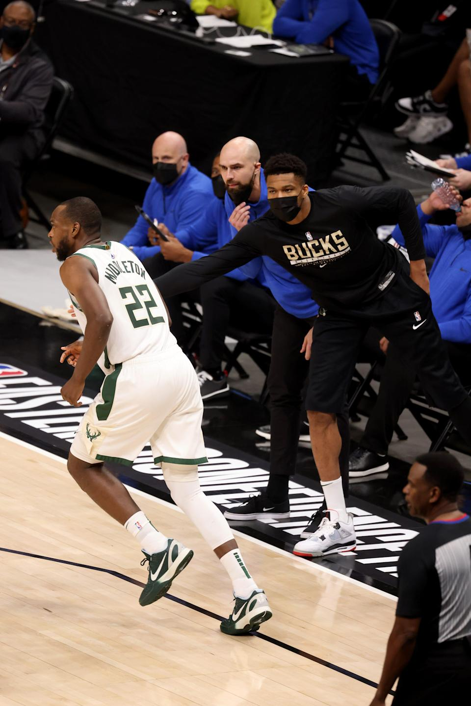 Giannis Antetokounmpo congratulates Khris Middleton after a basket during the third quarter of the Bucks' Game 6 win over the Hawks.