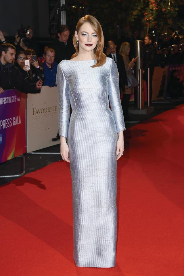 <p>Emma paired her backless, metallic dress by Louis Vuitton with velvety, dark lipstick and a starry hairpiece. <em>[Photo: Getty for the BFI]</em> </p>