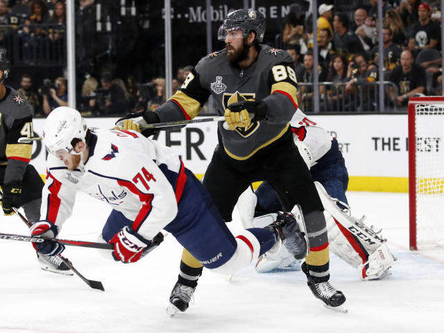 Vegas Golden Knights right wing Alex Tuch, right, shoves Washington Capitals defenseman John Carlson during the second period in Game 2 of the NHL hockey Stanley Cup Finals on Wednesday, May 30, 2018, in Las Vegas. (AP Photo/John Locher)