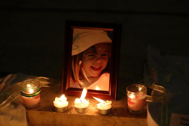 Candles light a photograph of Madeleine McCann inside the church of Praia da Luz, near Lagos, on May 3, 2017, during a mass ceremony marking the 10th anniversary of her disappearance.
