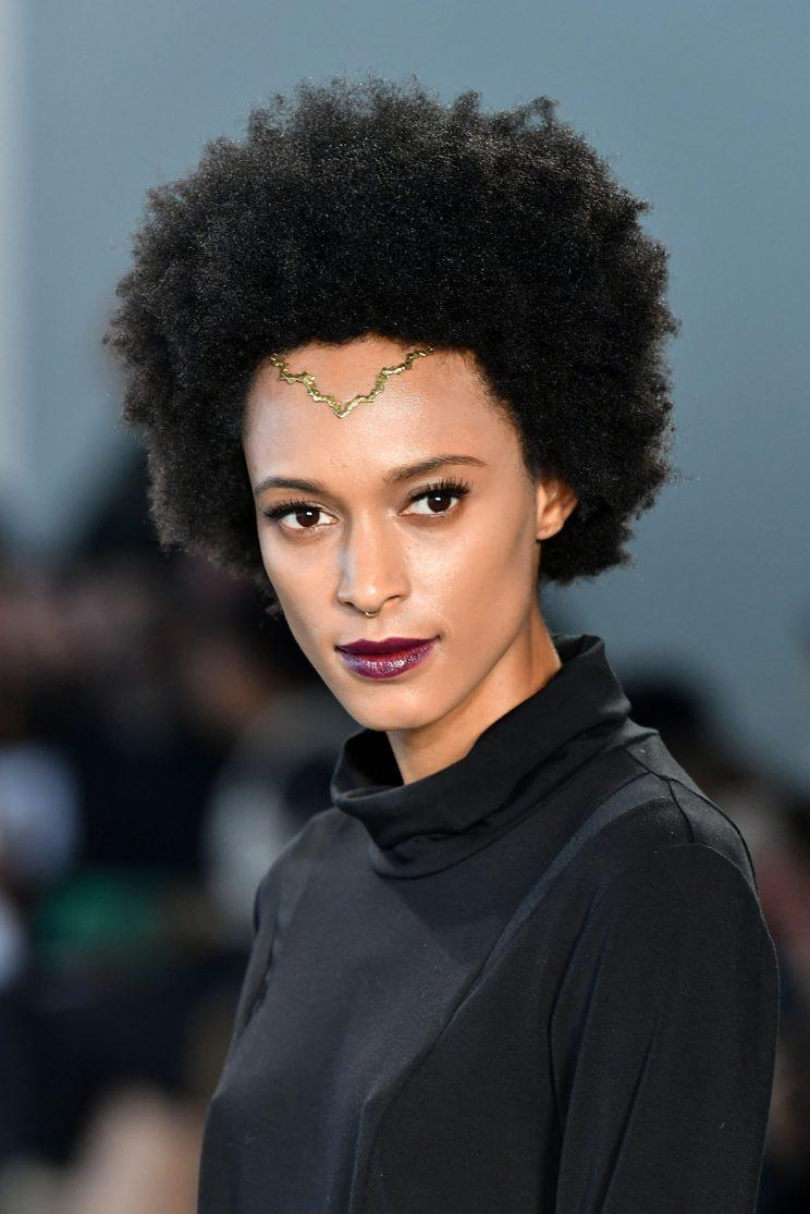 A fresh face and tease Afro is perfect for runway. (Photo: Getty Images)