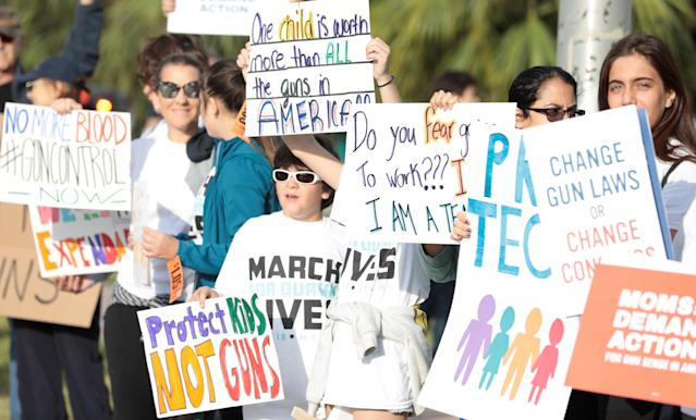 <p>People hold signs while rallying in the street during March for Our Lives, at the Miami Beach Senior High School in Miami, Florida. (Javier Galeano /Reuters) </p>