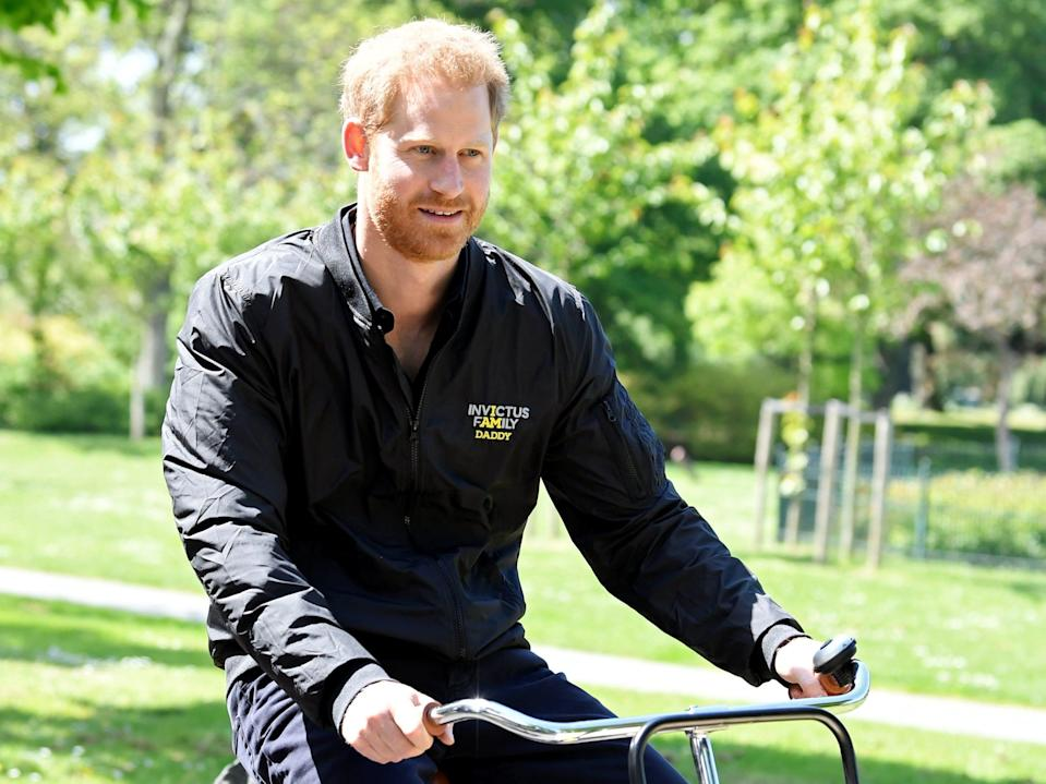 prince harry on a bicycle