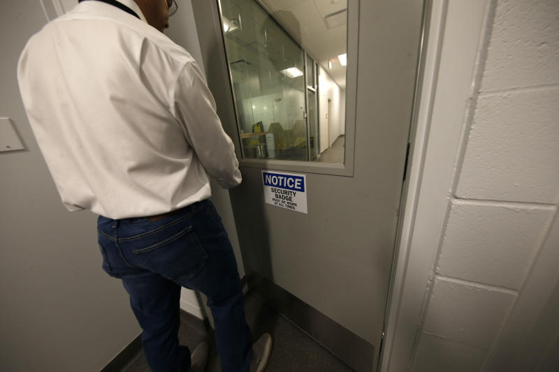 John Davis, president of GB Sciences Louisiana, walks through a secure area of the facility, which grows and processes medical marijuana, in Baton Rouge, La., Tuesday, Aug. 6, 2019. (AP Photo/Gerald Herbert)