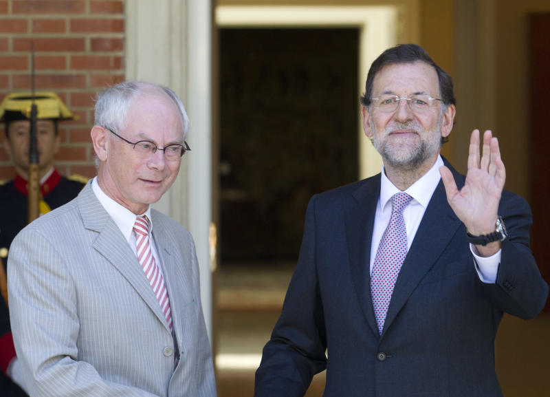 Spain's Prime Minister Mariano Rajoy, right waves next to European Council President Herman van Rompuy at the Moncloa Palace in Madrid Tuesday Aug. 28, 2012. Rajoy and van Rompuy met for talks on the economic crisis and Spain's battle to avert having to seek a sovereign bailout. (AP Photo/Paul White)