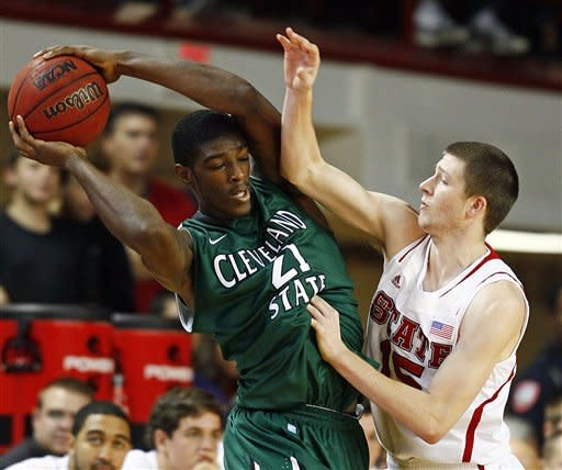 North Carolina State's Scott Wood (15) battles with Cleveland State's Marlin Mason (21) during the first half of an NCAA college basketball game in Raleigh, N.C., Saturday, Dec. 8, 2012. (AP Photo/Karl B DeBlaker)