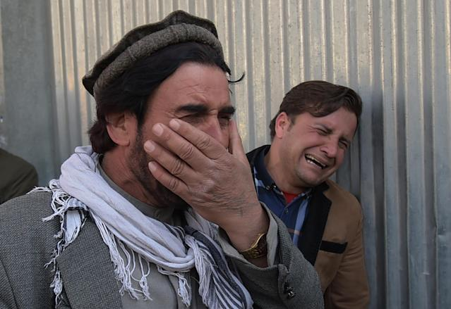<p>Two Afghan men weep for their relatives in front of the main gate of a military hospital in Kabul on March 8, 2017, after a deadly six-hour attack claimed by the Islamic State group.<br> More than 30 people were killed and around 50 wounded in an insurgent attack on Afghanistan's largest military hospital in Kabul on March 8, the defence ministry said. (Photo: Shah Marai/ AFP/Getty Images) </p>