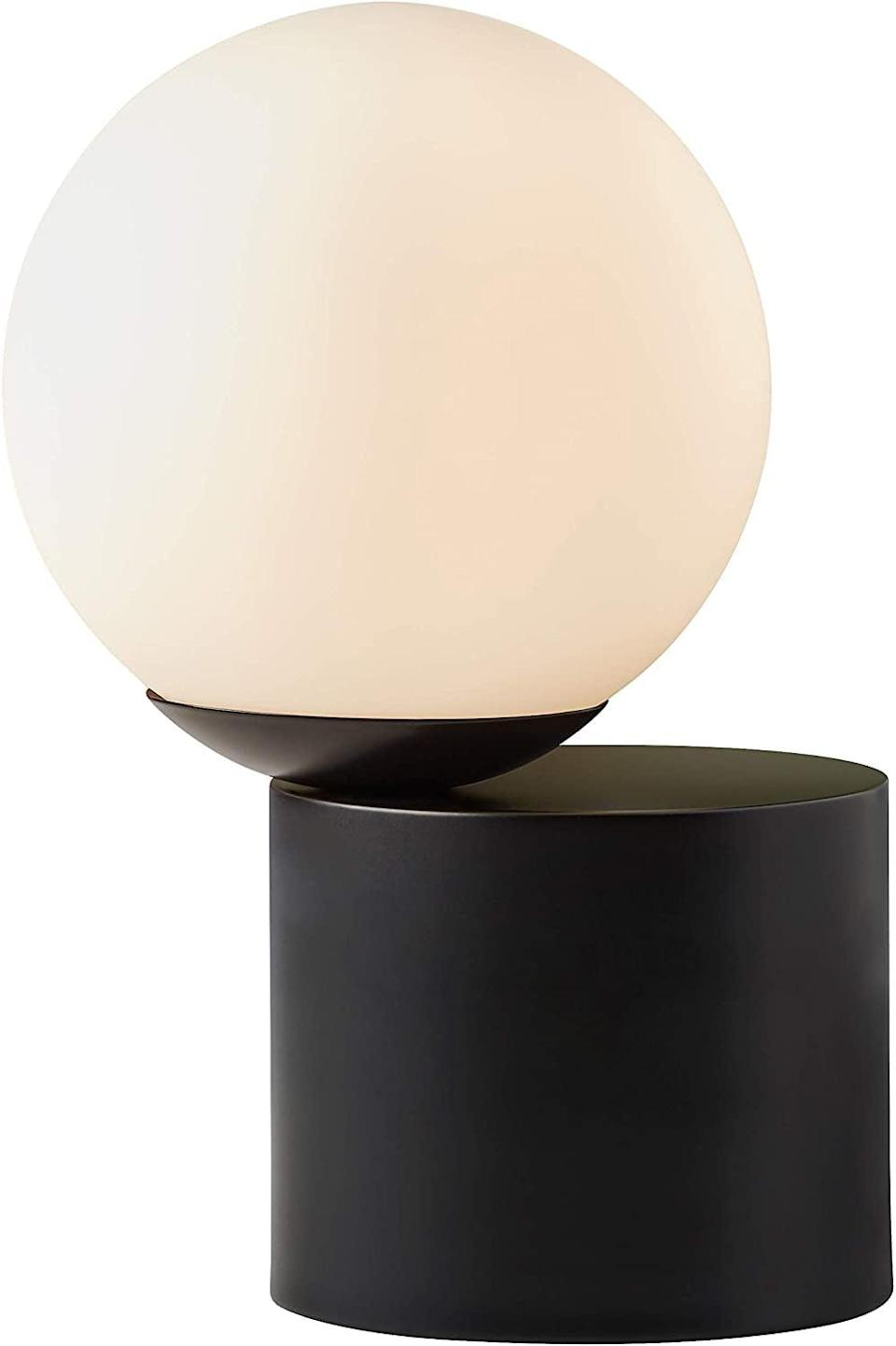 <p>This <span>Rivet Modern Glass Globe Living Room Table Desk Lamp</span> ($32, originally $35) also comes in gold. </p>