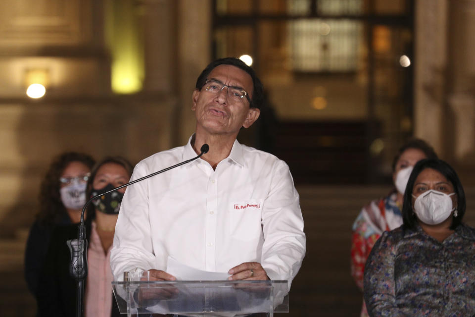 Peru's President Martin Vizcarra speaks in front of the presidential palace after lawmakers voted to remove him from office in Lima, Peru, Monday, Nov. 9, 2020. Peruvian lawmakers voted overwhelmingly to impeach Vizcarra, expressing anger over his handling of the coronavirus pandemic and citing alleged but unproven corruption allegations. (AP Photo/Martin Mejia)