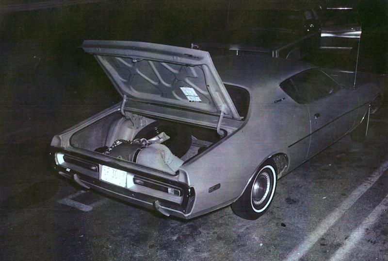 This June 1972 photo released by Waterbury Police Department via the Republican-American newspaper shows the body of John Sponza, formerly of Waterbury, in the trunk of a rented Dodge Charger in Waltham, Mass. The car was parked in a supermarket parking lot in Waltham, Mass. Sponza was the boyfriend of Diane McDermott, mother of actor Dylan McDermott, who was killed in 1967. Waterbury police reopened the investigation last year into Diane McDermott's death after Dylan McDermott contacted them with questions, the Republican-American newspaper reported Sunday and Monday, June 24-25, 2012, as part of a two-part series. An investigation concluded that actor Dylan McDermott's mother was killed in by Sponza, who lived with McDermott at the time. He had told authorities that McDermott accidentally shot herself after picking up a gun he had been cleaning. (AP Photo/Courtesy of Waterbury Police Department via The Republican-American)